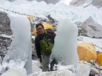 Trekking guide at EBC picture with snow man.